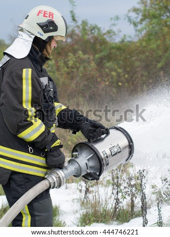 Szeged, Algyo, Hungary - October 8, 2015: Regional fire-fighting exercise in the training area with urban and contract firefighters.