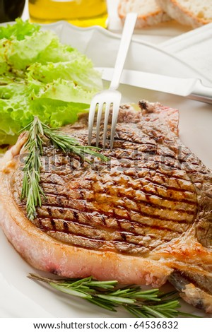 T-bone on dish - stock photo