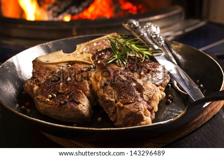 t-bone steak in the pan - stock photo
