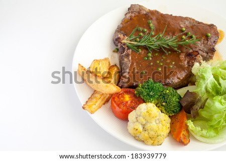 T-Bone Steak with Fresh Rosemary with Black Pepper Gravy Sauce. - stock photo