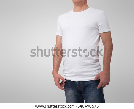 T-shirt design and people concept. Close up of man in blank white shirt isolated on gray background. Front view.