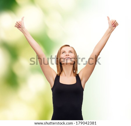t-shirt design, happy people concept - smiling woman in blank black tank top showing thumbs up - stock photo