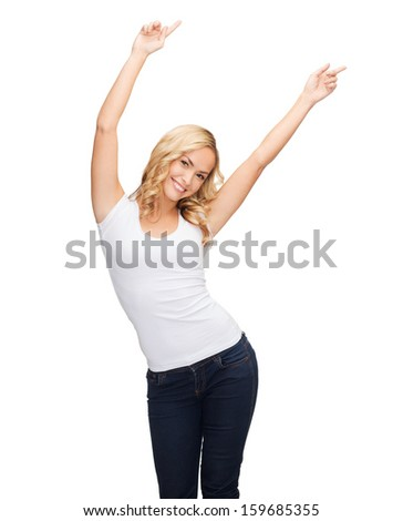 t-shirt design, harmony, happiness concept - happy dancing woman with raised hands in blank white t-shirt - stock photo