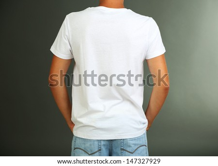 T-shirt on young man, on grey background