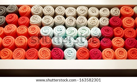 T-shirt rolled in shelf, Abstract background - stock photo