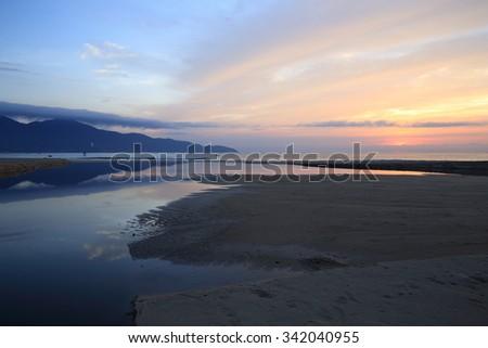 T20, T18, My Khe Beach, Danang, Da nang, Vietnam in the sunrise. You can enjoy the Han river, Son Tra mountain, Beautiful beach in the heart of this beautiful city. 30 km far away from Hoi An. - stock photo