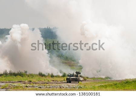 T-90 tank making smoke screen for defending. Russia
