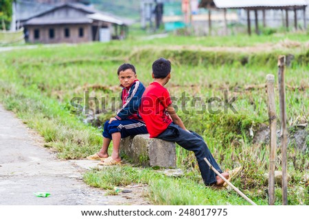 TA PHIN, LAO CAI, VIETNAM - SEP 21, 2014:  Unidentified Red Dao boys. Red Dao is one of the minority ethnic groups in Vietnam