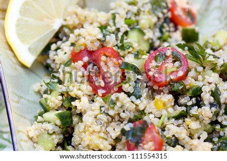 Tabbouleh Quinoa with tomatoes, cucumber, mint, garlic, parsley and lemon