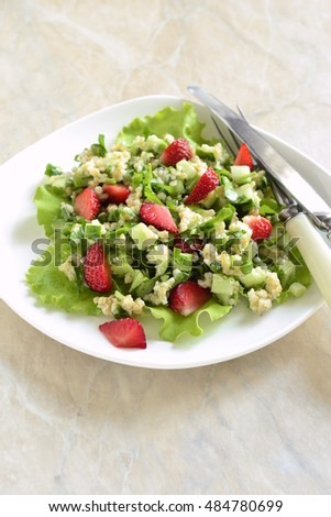 Tabbouleh with strawberries, bulgur and vegetables, vertical