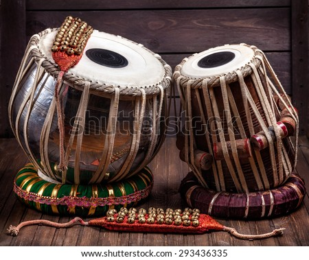 Tabla drums and bells for Indian dancing on wooden background  - stock photo