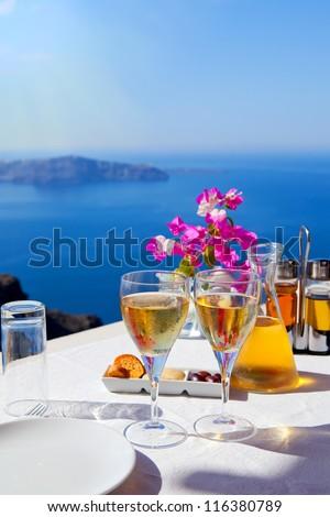 Table above sea for two. Greece, Santorini island - stock photo