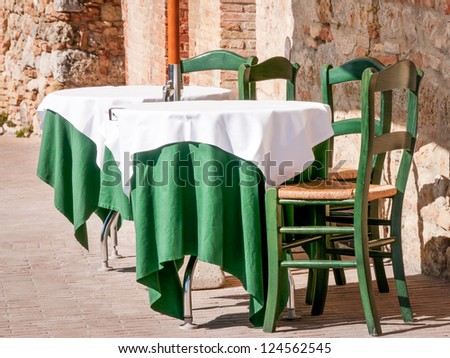 table and chairs at a cafe - stock photo
