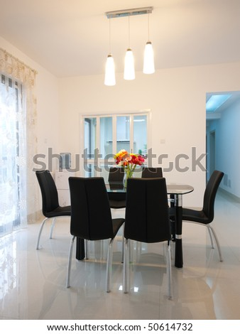 table and chairs in a modern dining room
