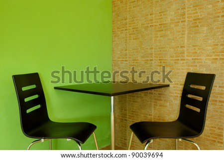 Table and Chairs in Coffee Shop - stock photo