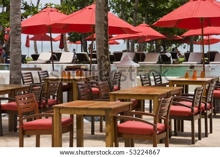 Table and chairs in empty cafe - stock photo