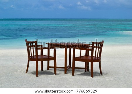 Table and chairs on the shores of the Indian Ocean - on the Maldives