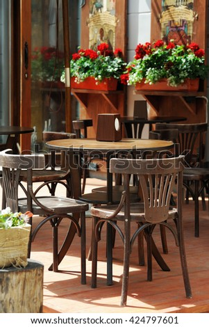 Table and chairs on the terrace of the restaurant - stock photo