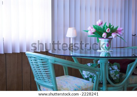 table and chairs set up nice in a sun room - stock photo