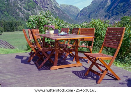 table and chairs standing on a lawn at the garden, norway