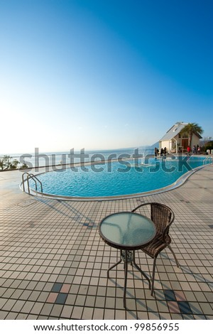 Table and chairs with sunrise - stock photo