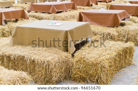 table and straw chair - stock photo