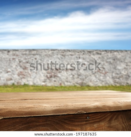 table and wall in garden  - stock photo