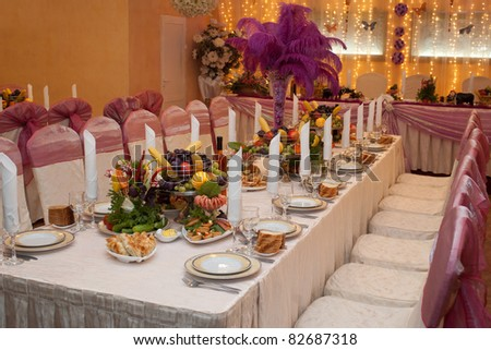 Table appointment for guests with appetizers on a banquet table with selective focus - stock photo