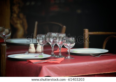 Table appointments  in the bistro street. Photo with tilt-shift lens - stock photo