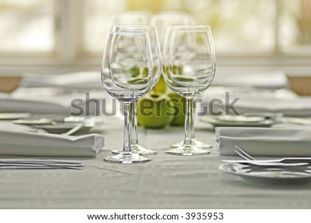table appointments with apples and wine glasses - stock photo