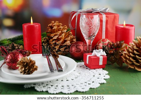 Table appointments with present boxes and Christmas decoration background