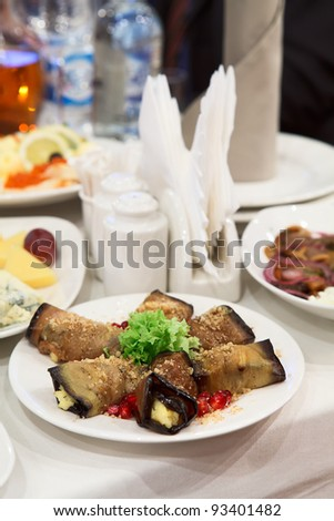 Table appointments with snacks. Plate with fork and knife - stock photo