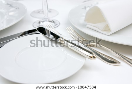 Table arrangement in very expensive haute cuisine restaurant - stock photo