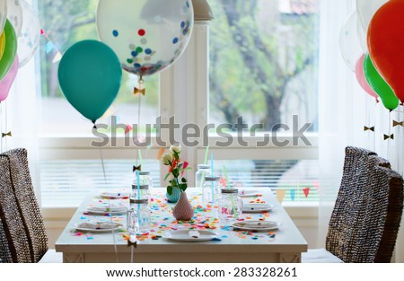 Table beautifully decorated for a colorful birthday party - stock photo