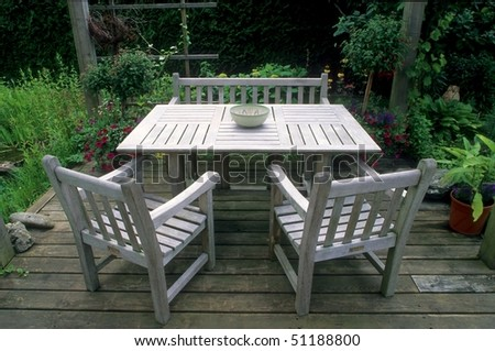 Beau Table, Bench And Chairs Of Teak In The Garden