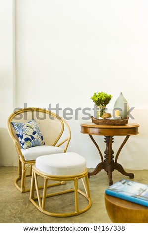 Table chair combination bamboo rattan seating area beautiful interior design - stock photo
