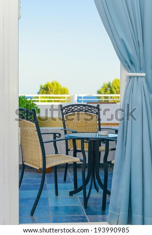 table chair on the veranda of a private house - stock photo