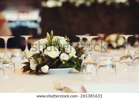 Table decor with flowers white roses  - stock photo