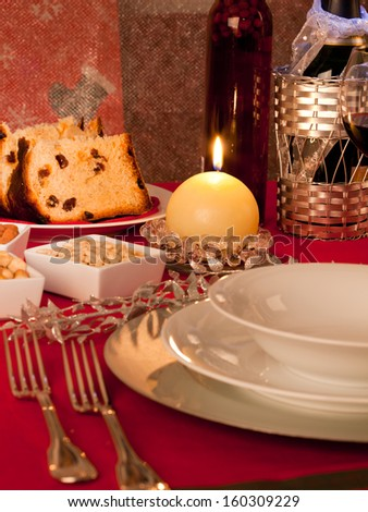 Table decorated for Christmas dinner with warm lighting - stock photo