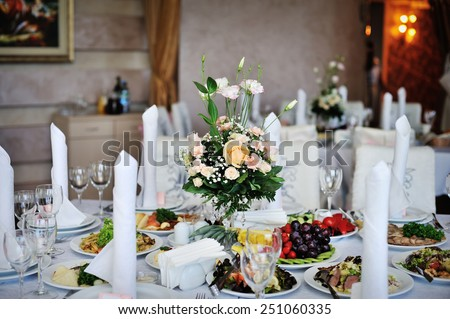 table decorated with flowers wedding dinner. - stock photo