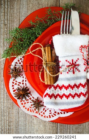 Table decoration for Christmas eve with bright table set - stock photo