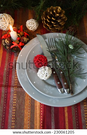 Table decoration for Christmas eve with bright table set