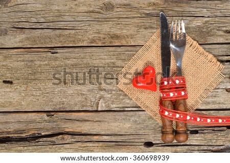 Table decoration Valentine's Day, table set with a ribbon and a decorative heart. Image of dinner on Valentines day. Top view, copy space. - stock photo