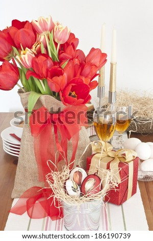 Table decoration with red tulips