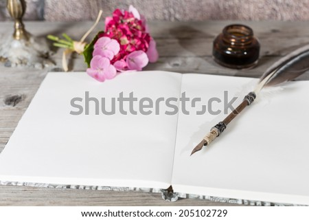 Table desk with an old pen and candle - stock photo