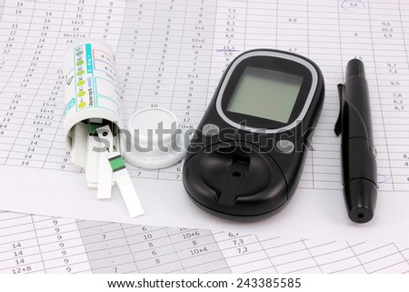 Table diabetic, glucometer, lancet and test strips - stock photo