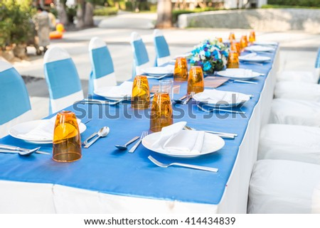 Table dining set at outside of the hotel restaurant - stock photo