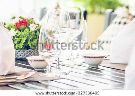 Table dining set in the hotel restaurant - light vintage filter effect processing style pictures - Selective focus point - stock photo