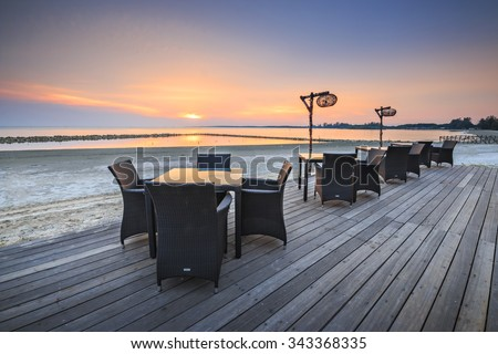Table dinner on the beach on twilight time in Bagan Lalang, Selangor, Malaysia. - stock photo
