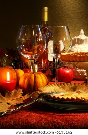 Table elegantly set with wine  for Thanksgiving - stock photo